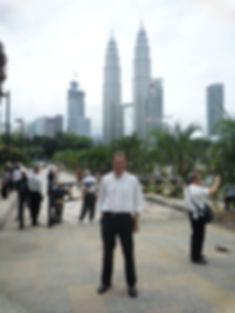 Malcolm Teasdale in front of Petronas Towers, Kuala Lumpur, Malaysia
