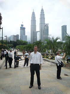 Malcolm Teasdale in front of Petronas Towers in KL Malaysia