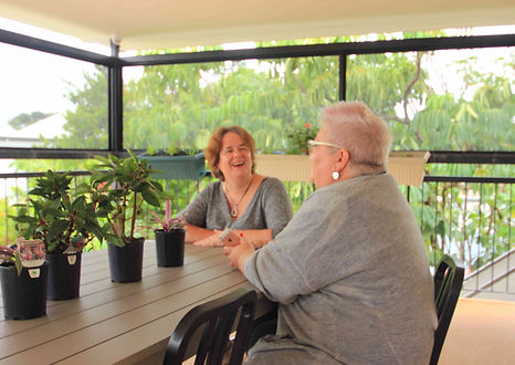 Women chat at group home for mentally disabled adults