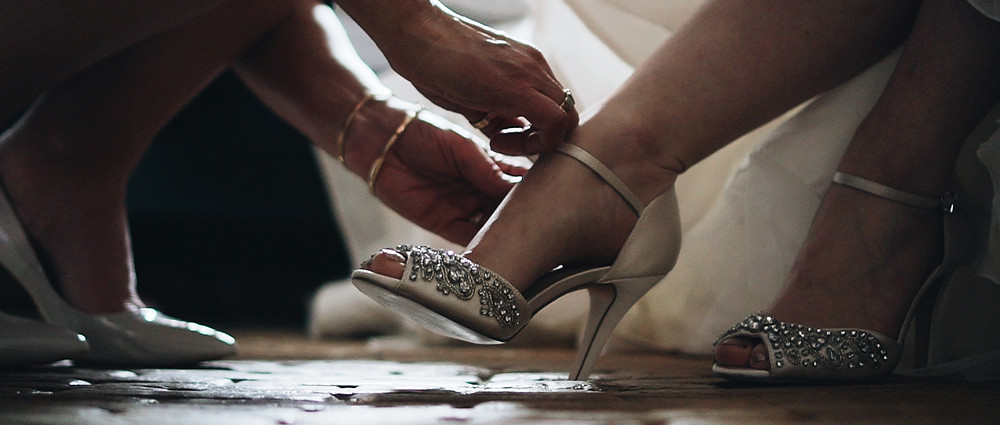 brides shoes | West Sussex wedding videographer | Ground Films