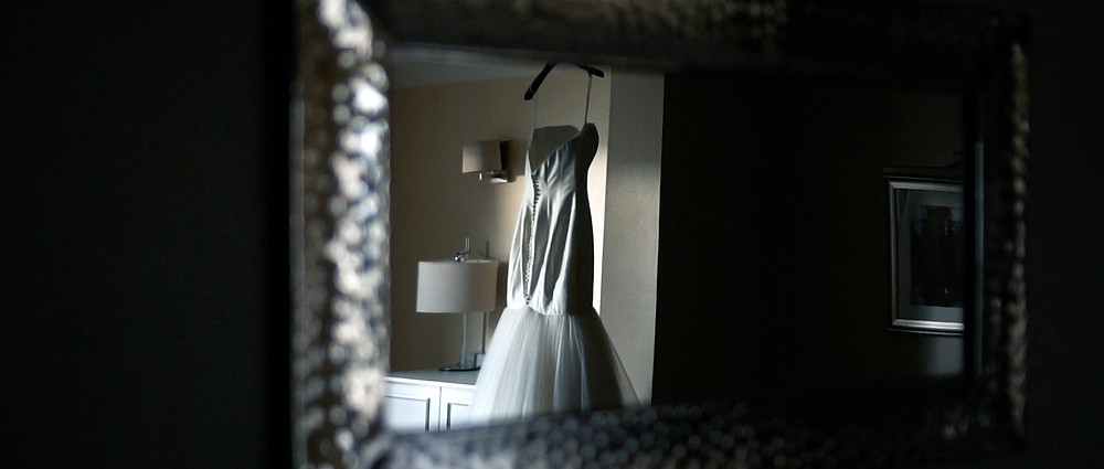 brides dress in mirror at Elmore Court - Ground Films