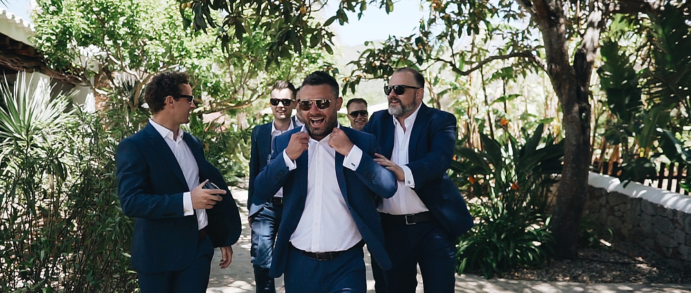 Groomsmen having a laugh at agroturismo Can Gall