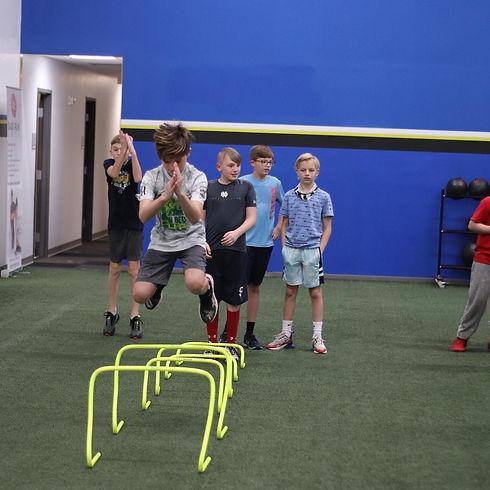 boys hurdle jumps 2.jpg