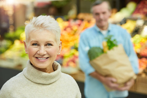 smiling-senior-woman-in-supermarket-GBQA