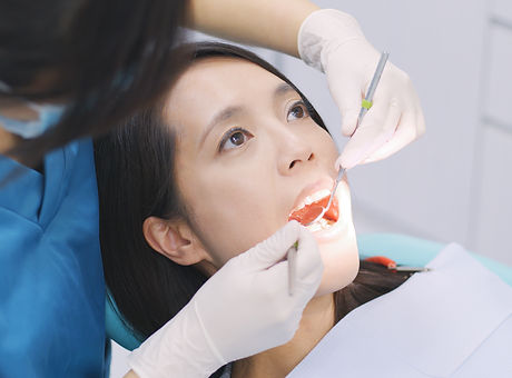 dentist-examining-a-patient-teeth-in-the