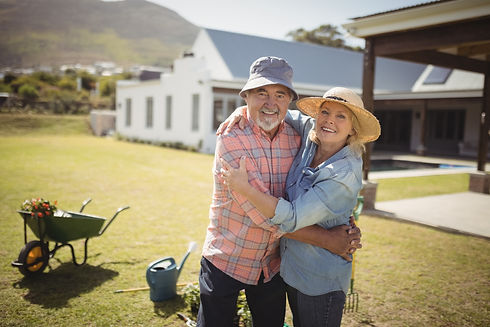 smiling-senior-couple-embracing-each-oth