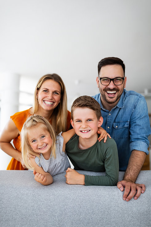 portrait-of-happy-smiling-family-at-home