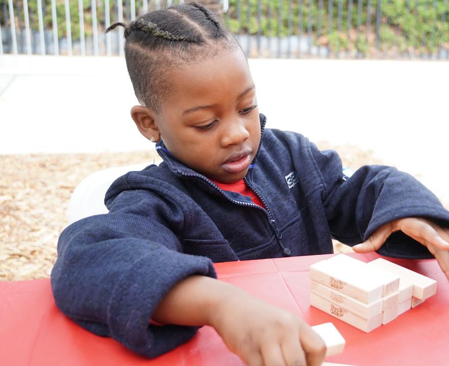 kid with blocks.jpg