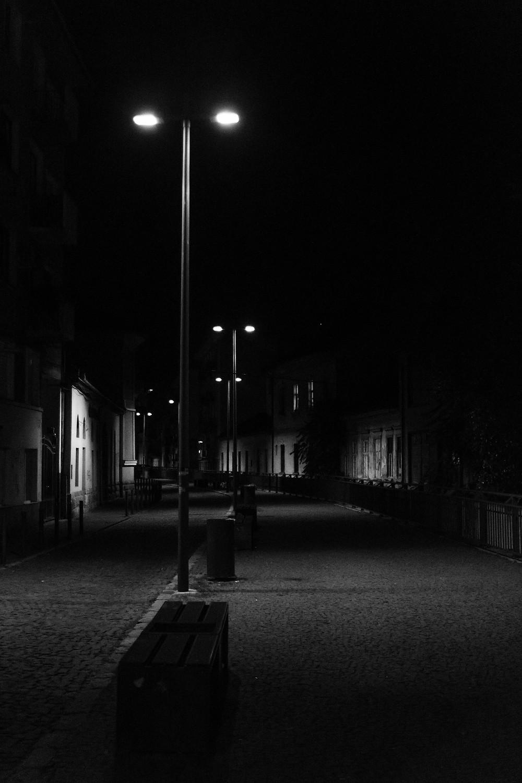 Street at night, dim lights.