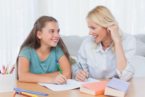 Happy middle school student and tutor working on grade 8 and grade 9 math homework.