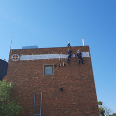 Signage installation at heights