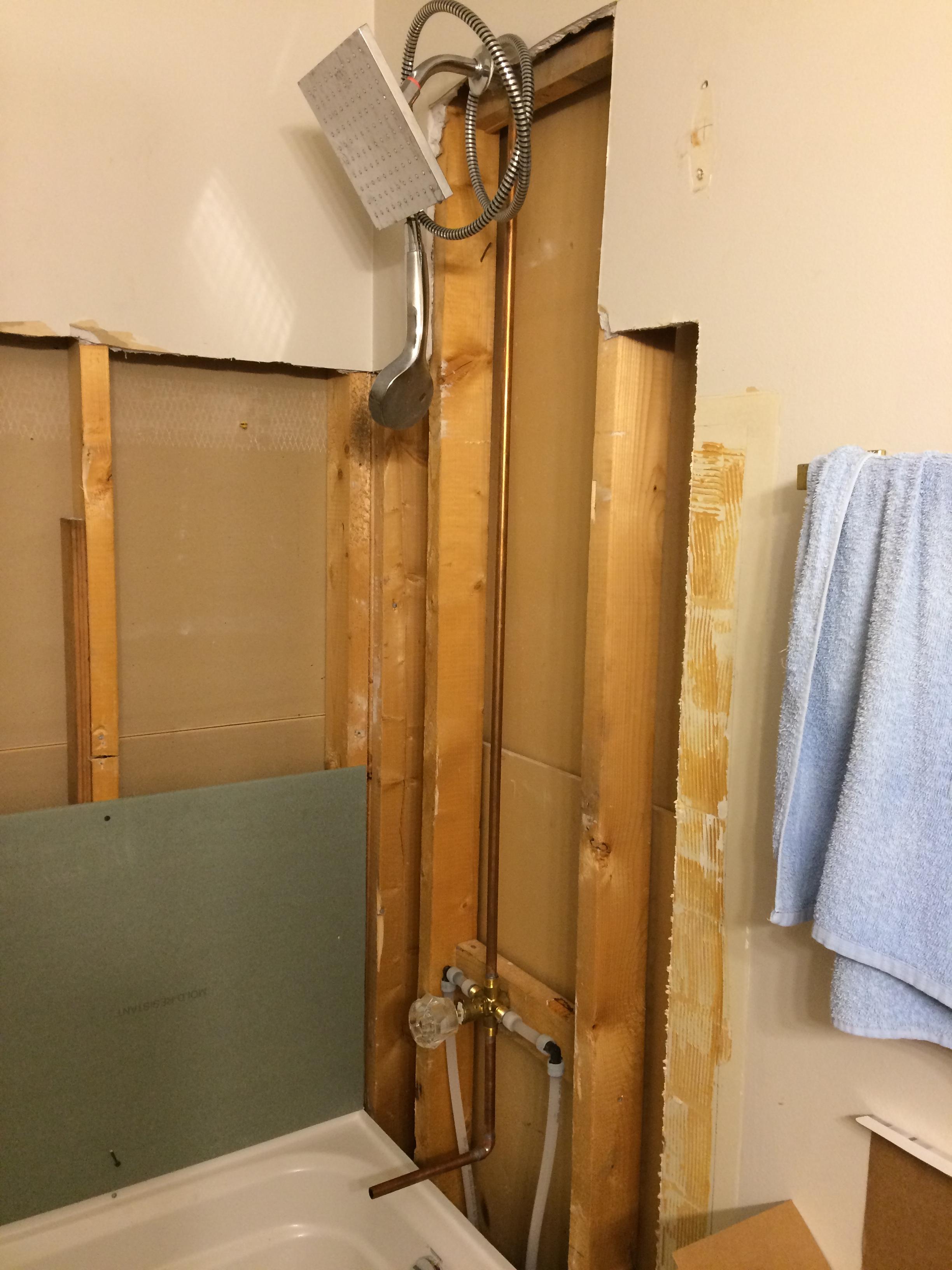 Bathroom tub surround reno (during)