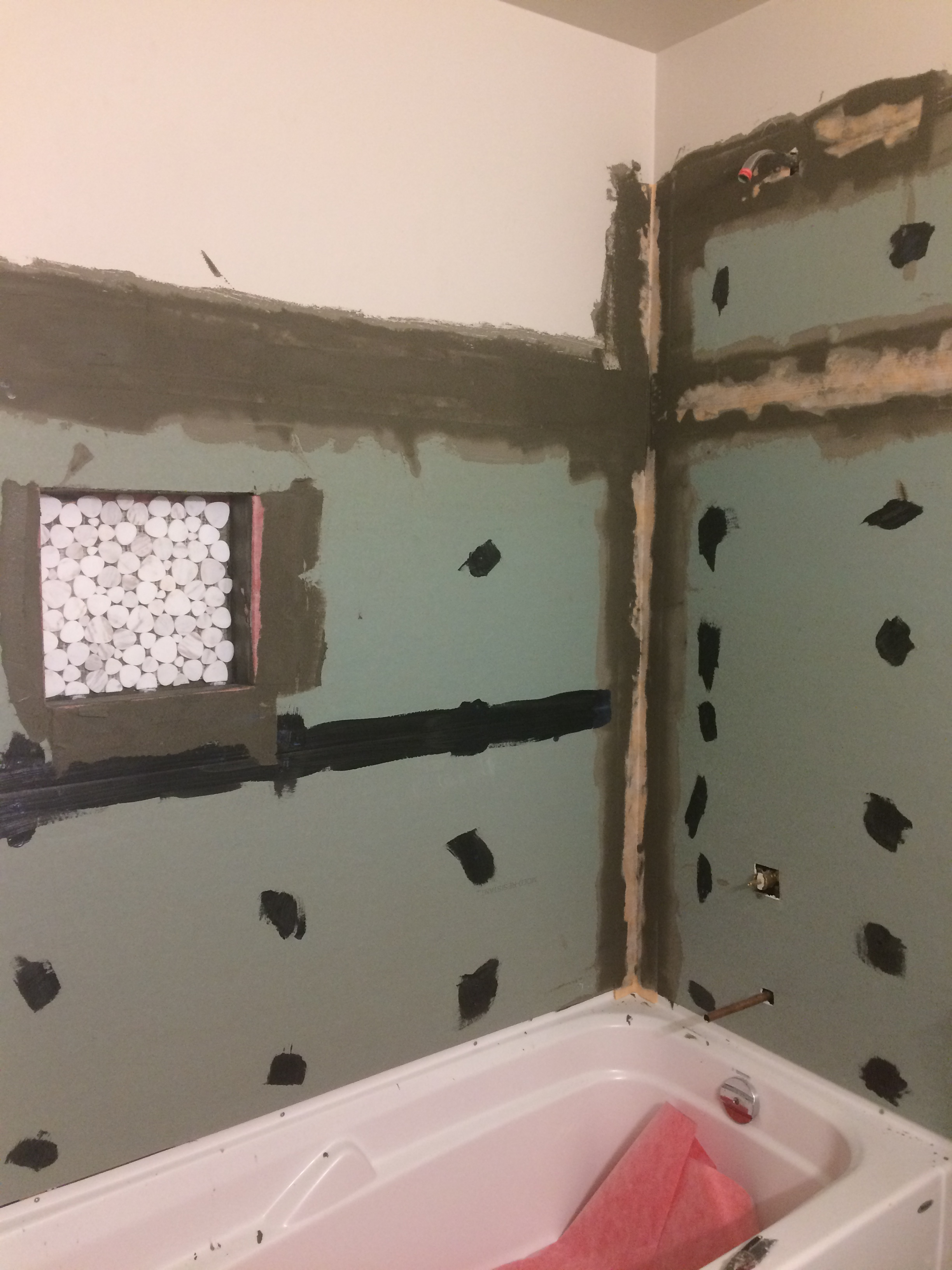 Bathroom tub surround reno (during)