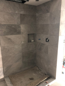 Commercial tile job. Marble 12x24 with mitring in Downtown Vancouver