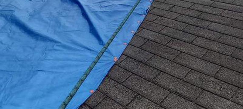 Emergency Roof Repair: Patching and Tarping
