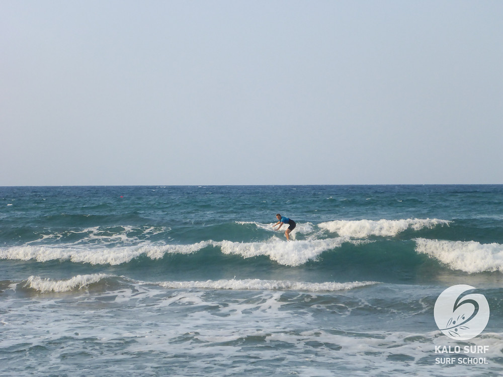surf lesson Greece, take off and turning