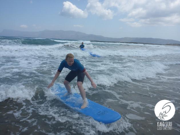 Surfer girl in Crete