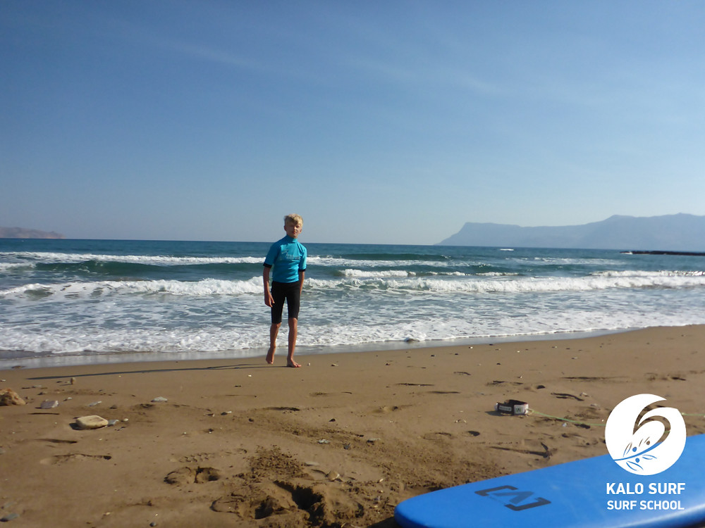 preparations for surfing lesson, waves in Crete