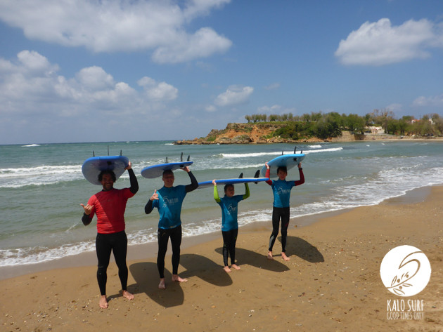 surfers posing with surf boards in Crete