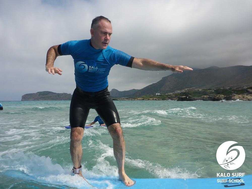 surfer surfing a wave in Falassarna