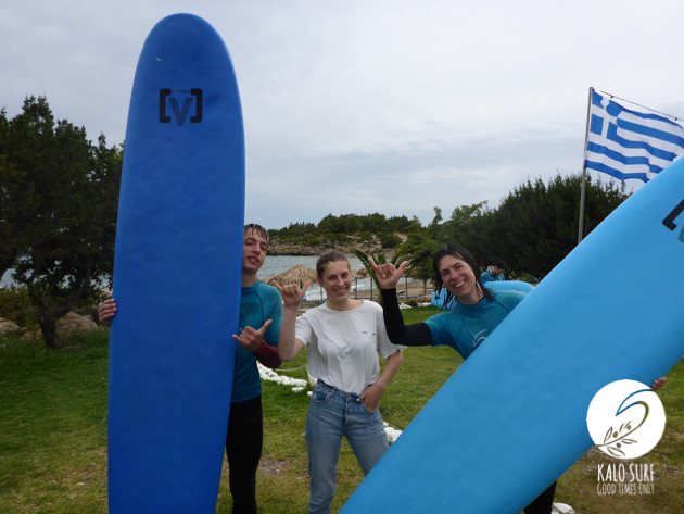 Shaka, posing with surfboards in Crete, Greek flag