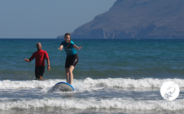surfing lesson in kissamos girl on surfboard