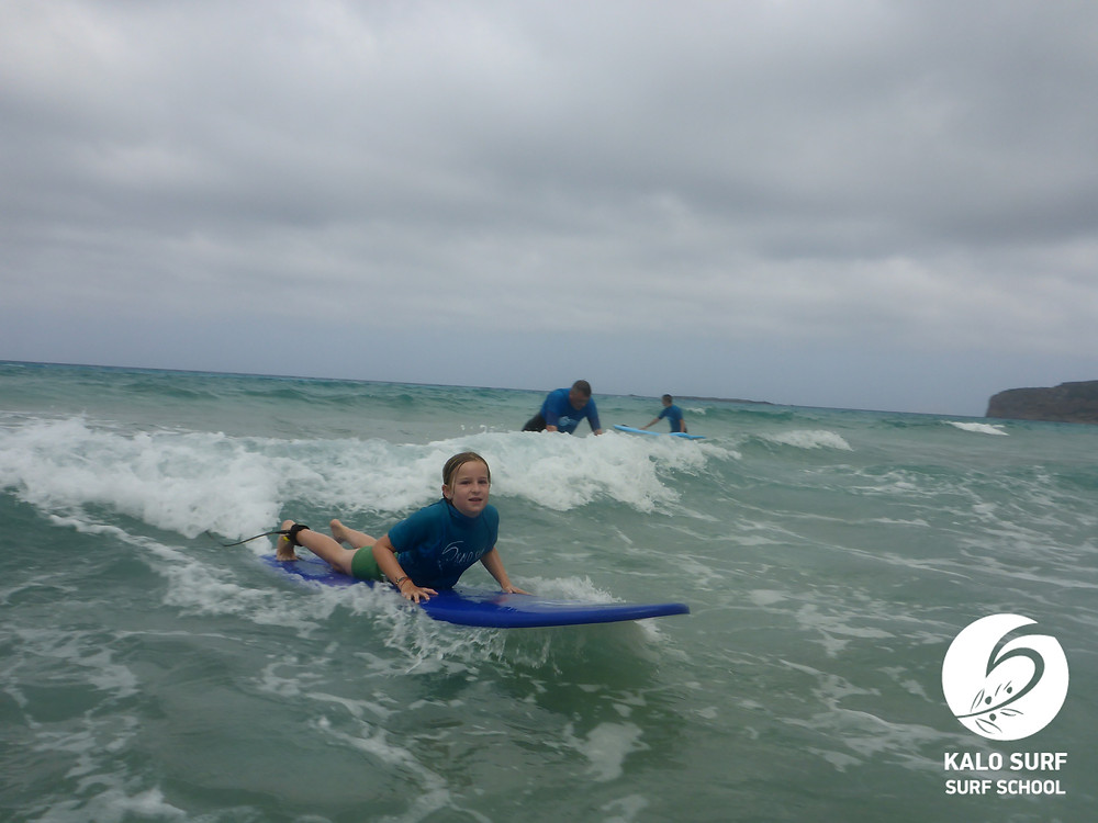 9 year old kid surfer catching waves in Falassarna