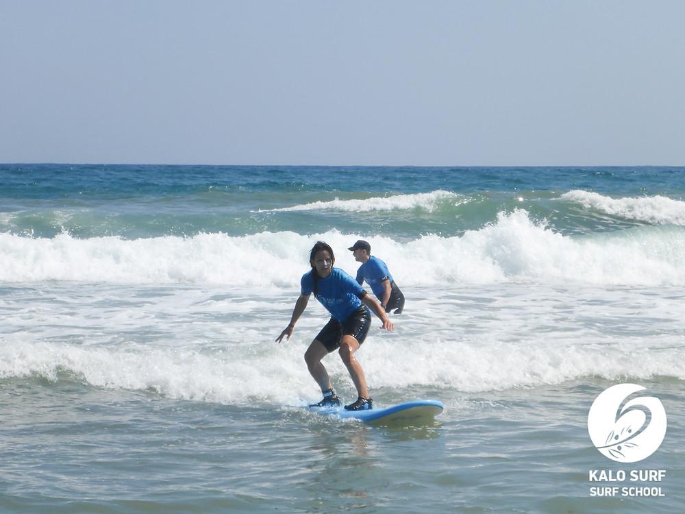 surfer girl in Crete big swell Crete