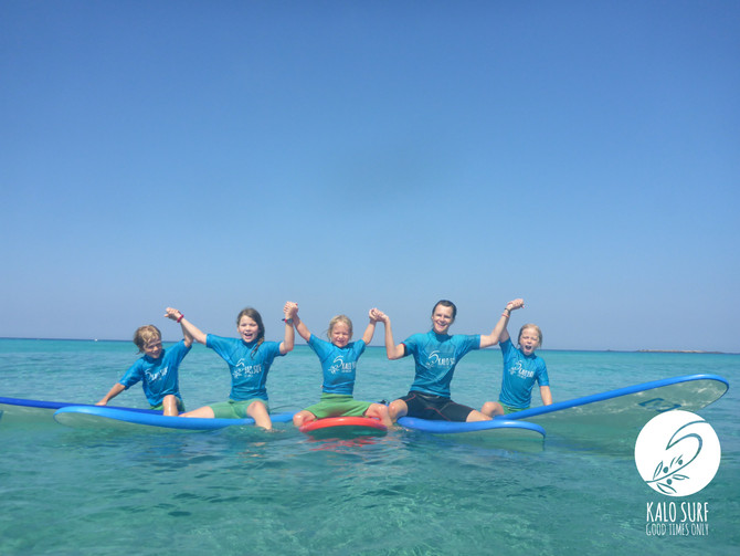 Kids learn how to surf in Crete