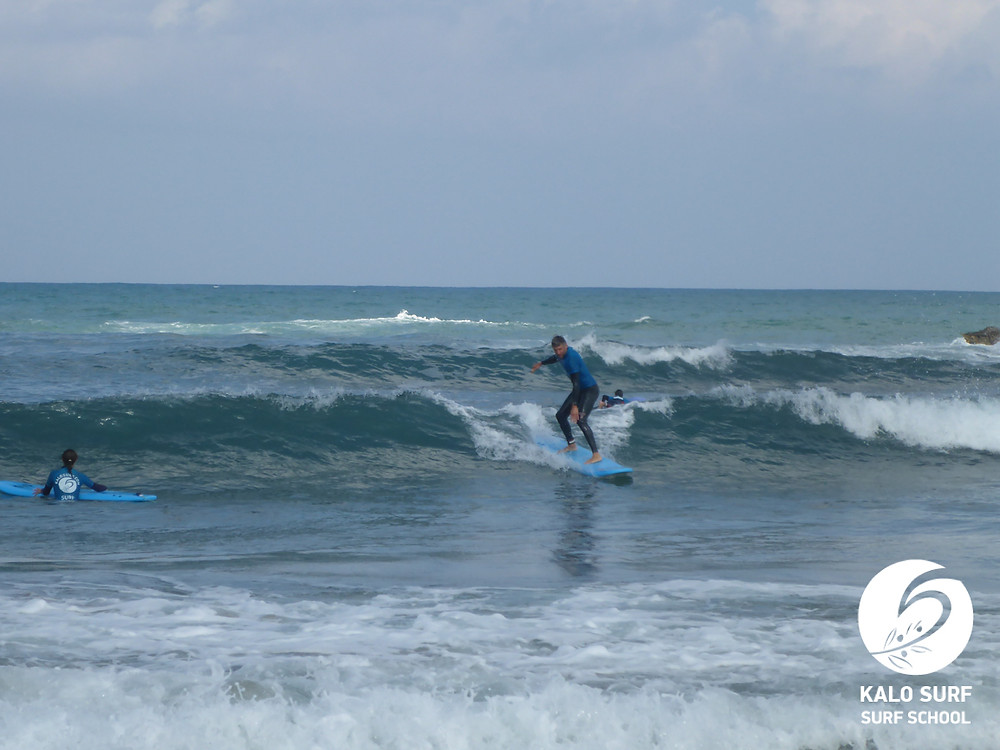point break in Kissamos, surfer taking off
