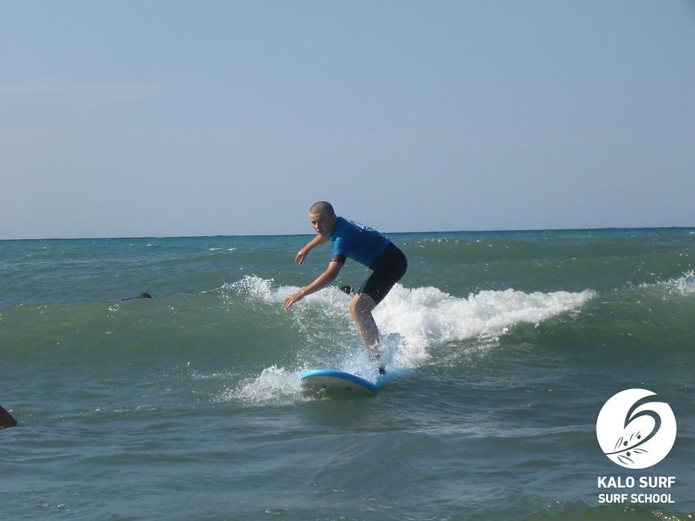 Teenage surfer surfing a wave in Crete
