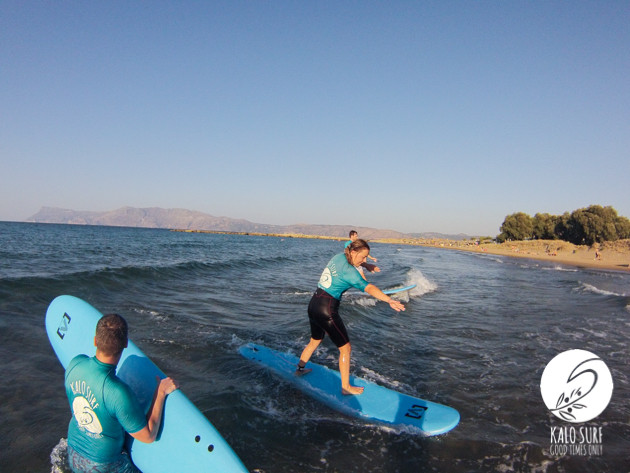 surfing in Kissamos, softboard, wetsuit, female surfer