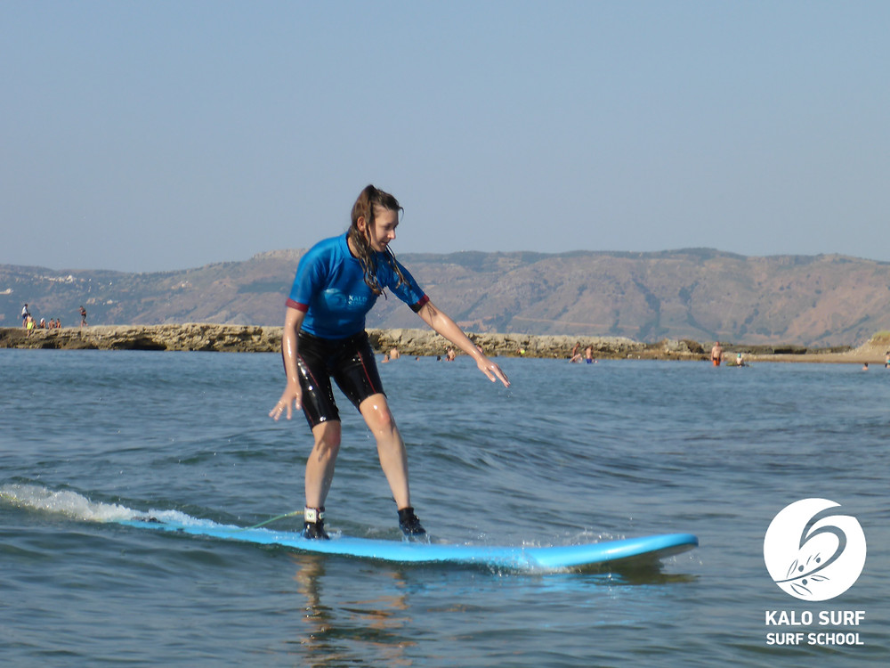 surfing on a surfboard in Kissamos