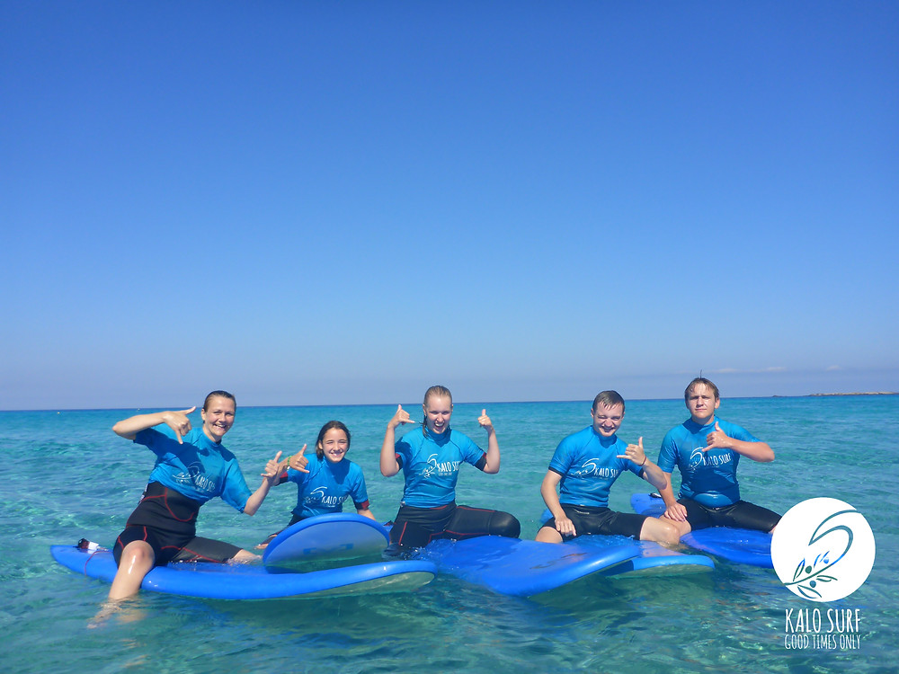 Group Picture in the water on surfboards