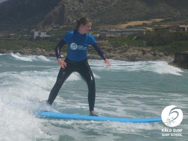Surfing waves in Falassarna Crete
