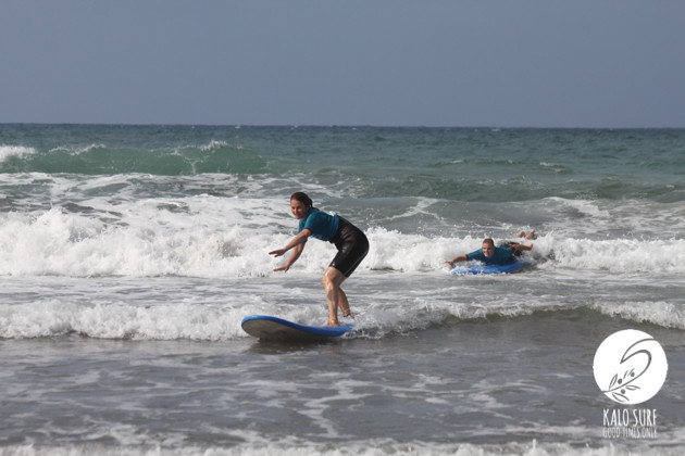 first wave in greece for surfer girl