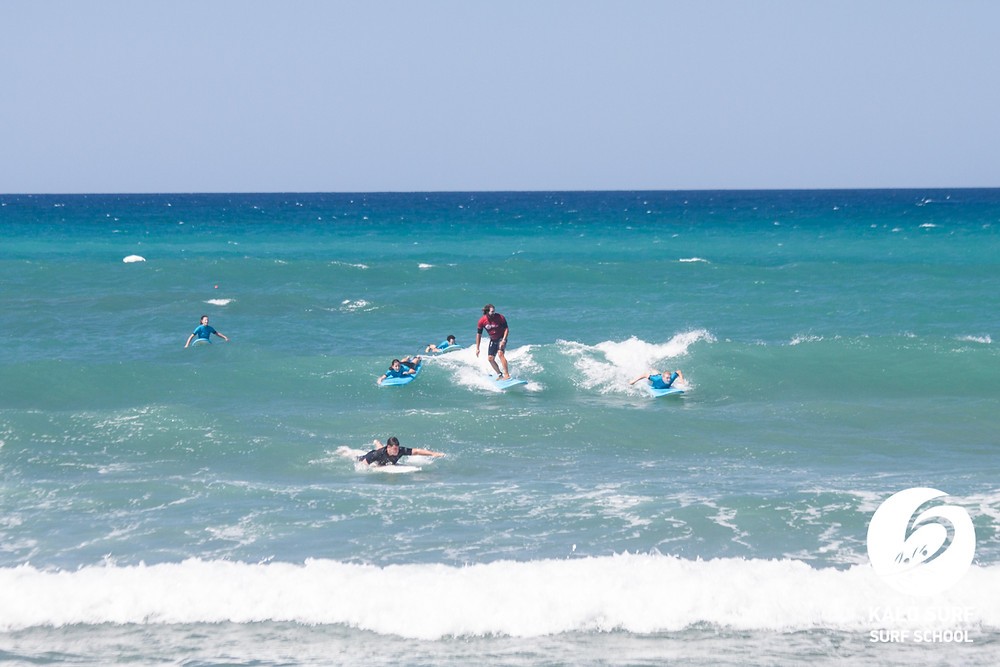 take off on a green wave Surfing in Crete Greece