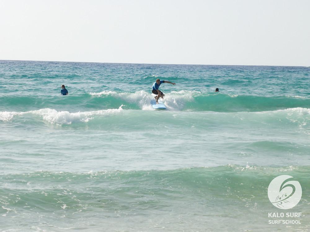 catching waves, beginner surf lesson, Crete