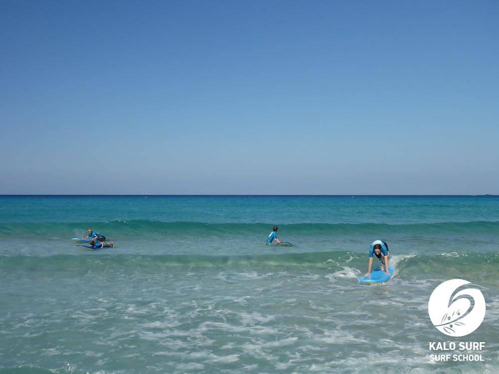 green waves in Falassarna, surfing lesson