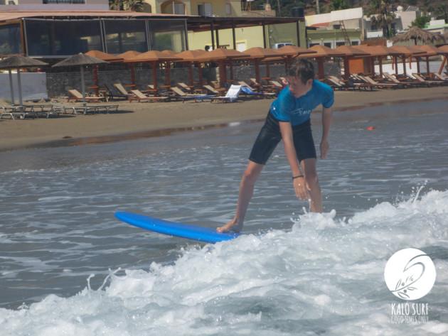 teenager surfing in Crete