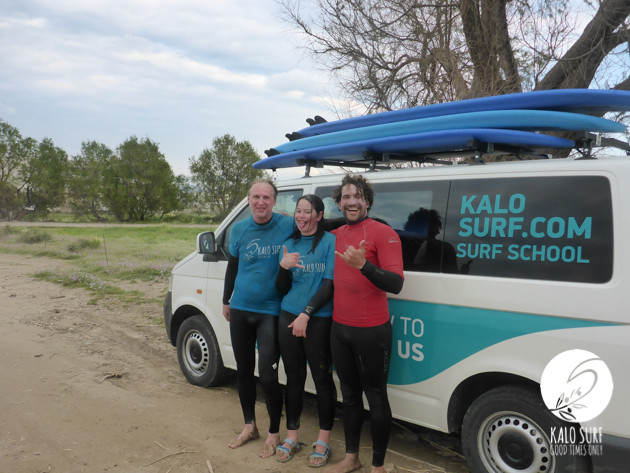 surfers happy and tired posing with Kalo Surf van