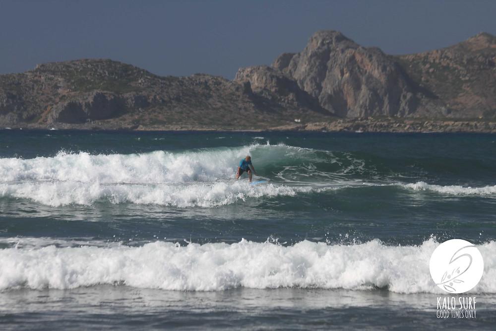 Surfer on Reef Break in Crete
