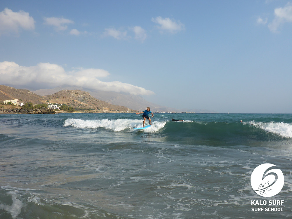 surf lesson, surfer on a green wave