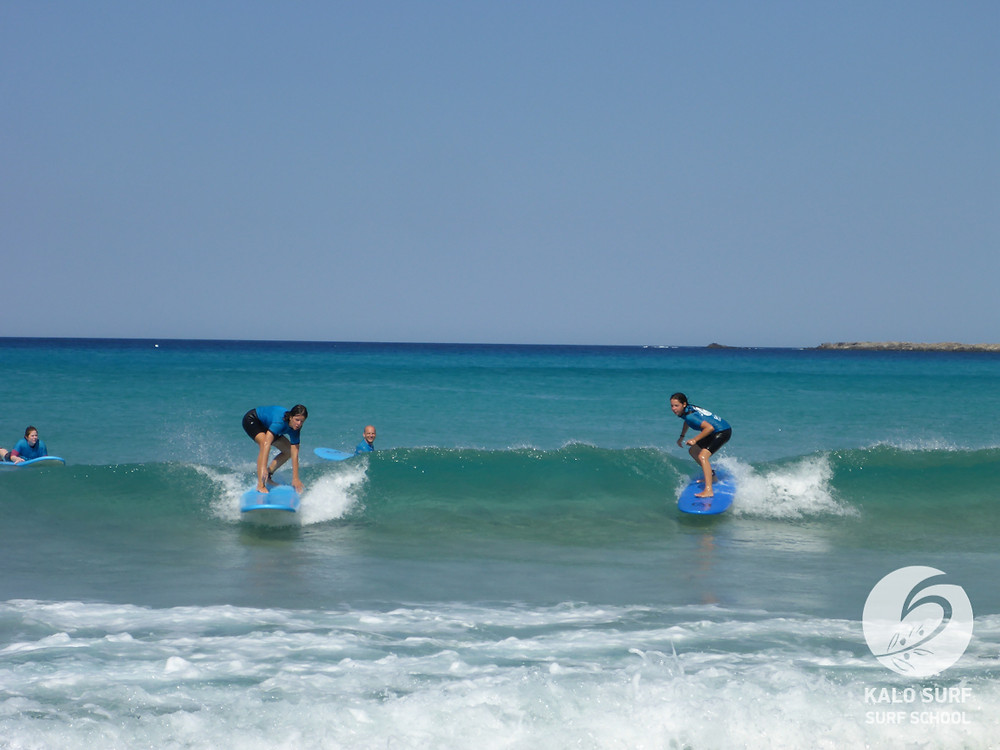 taking off on green waves surf lesson Greece