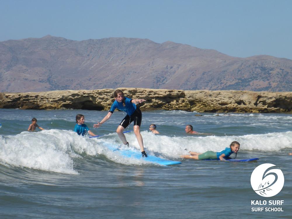 Teen Surfer surfing a wave in Crete