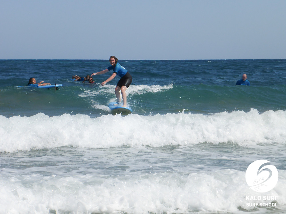 surfing green wave in Crete, surfboard, surf lesson