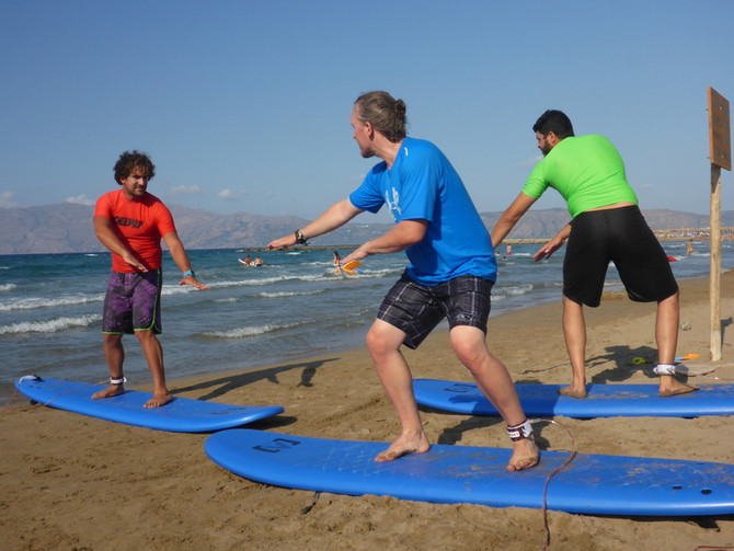 First Surfing Steps on a Sunny Day in Greece