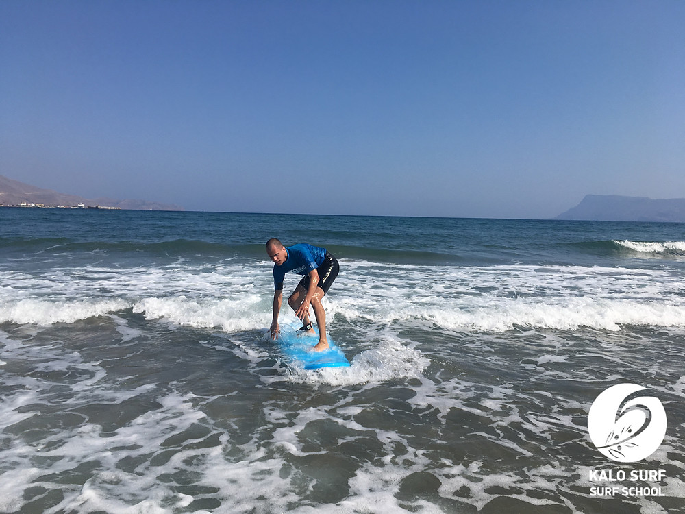 surfer catching wave in the bay of Kissamos