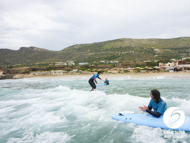 learning surfers cheering each other on in Crete