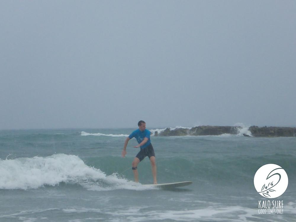 Surfer on green wave in Greece